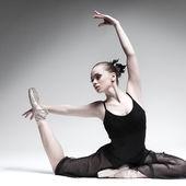 Beautiful ballet-dancer, modern style dancer posing on studio background — Stock Photo