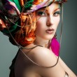 A photo of beautiful redheaded girl in a head-dress from the coloured fabric, glamour — Stock Photo #24095195