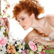 Beautiful redheaded girl with the bouquet of tulips, which stands in a gold frame, flowered, isolated on a white background - Stock Photo