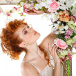 Beautiful redheaded girl with bouquet of tulips, which stands in gold frame, flowered, isolated on white background — Stock Photo #25177277