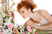 Beautiful redheaded girl with the bouquet of tulips, which stands in a gold frame, flowered, isolated on a white background — Stock Photo