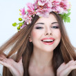 Close-up portrait of beautiful young girl with pink flowers — Stock Photo