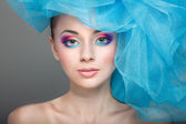 Portrait of beautiful girl with a hat from a blue veil — Foto de Stock
