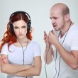 A young man and girl listen music — Stock Photo