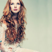 A portrait of stylish elegant redheaded girl is in lace clothes . — Stock Photo