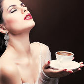 Beautiful young girl with the cup of coffee — Stock Photo