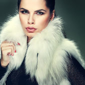 A photo of sexual beautiful girl is in fashion style is in fur clothes — Stock Photo