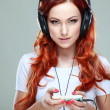 Beautiful girl with headphones — Stockfoto