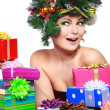 Stock Photo: Christmas Woman. Beautiful New Year and Christmas Tree Holiday Hairstyle and Make up.