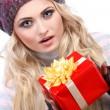 A photo of beautiful girl is in winter clothes with red gift box,  isolated — Stock Photo