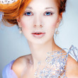 Redheaded girl with new-year decorations in a hair-do. Beautiful New Year and Christmas Tree Holiday Hairstyle and Make up. — Stock Photo #37094949