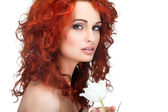 Beautiful young redheaded girl with white tulips, isolated on a white background — Stock Photo