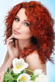Beautiful young redheaded girl with white tulips — Stock Photo