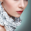Beautiful girl with silver metallic foil on a neck, isolated on a light - grey background, emotions, cosmetics — Stock Photo #45456869