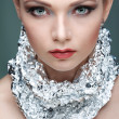 Beautiful girl with silver metallic foil on a neck, isolated on a light - grey background, emotions, cosmetics — Stock Photo #45456899