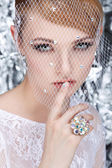Beautiful white-headed girl in a veil on a silvery background, emotions, cosmetics — Stock Photo