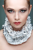 Beautiful girl with silver metallic foil on a neck, isolated on a light - grey  background, emotions, cosmetics — Foto de Stock