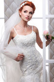 A photo of sexual beautiful bride in a wedding-dress is in fashion style. Wedding decorations — Stok fotoğraf