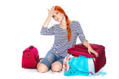 Beautiful redheaded tourist woman . Isolated on a white background — Stock Photo