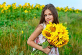 Little glad girl with yellow on green a meadow, emotions, lifestyle — Stock Photo
