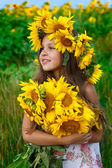 Little glad girl with yellow on green a meadow, emotions, lifestyle — Foto Stock