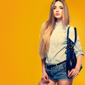 A photo of beautiful girl is in fashion style on  yellow  background, glamour — Foto de Stock