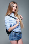 A photo of beautiful girl is in fashion style on  grey  background, glamour — Stock Photo