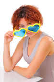 Beautiful young girl with big sunglasses — Stock Photo