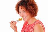 Leende ung flicka äta välsmakande sallad — Stockfoto