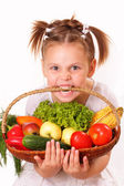 Funny little girl with vegetables and fruits — Stock Photo