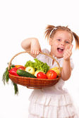 Happy little girl with vegetables and fruits — Stock Photo