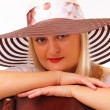 Beautiful blonde lady in a hat — Stock Photo