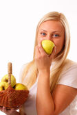 Beautiful blonde woman eating apple — Stock Photo