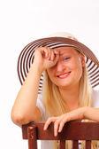 Cheerful blonde woman in a hat — Stock Photo