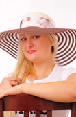 Happy blonde woman in a hat — Stock Photo