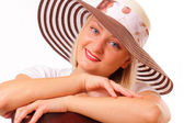 Smiling blonde woman in a hat — Stock Photo