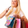 Happy blonde woman goes shopping — Stock Photo