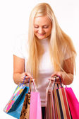 Blonde woman with purchases — Stockfoto
