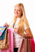 Happy blonde shopping woman — Stock Photo