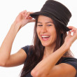 Happy young brunette woman in a hat — Stock Photo