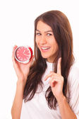 Attractive young brunette woman with alarm clock — Stock Photo
