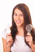 Happy young brunette woman with electric lamps — Stock Photo