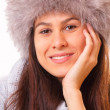 Pretty brunette woman in a fur hat - Stock Photo