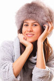 Attractive brunette woman in a fur hat — Foto Stock