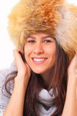 Charming brunette woman in a fur hat — Stock Photo