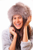 Funny brunette woman in a fur hat — Stock Photo