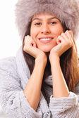 Happy brunette woman in a fur hat — Stock Photo