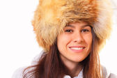 Young and beautiful brunette woman in a fur hat — Stock Photo