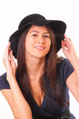 Attractive woman in a black hat — Fotografia Stock