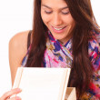 Beautiful young woman opens a holiday gift — Stock Photo #16970665